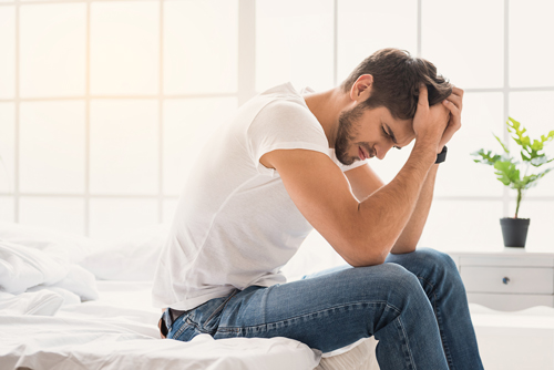 detox from alcohol - young man sitting on bed - willingway