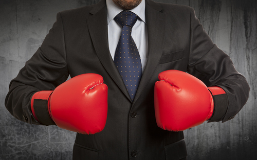 Fight against Addiction - man in suit with boxing gloves - willingway