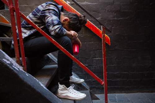How to Recognize Addiction in a Loved One - drunk man on stairs