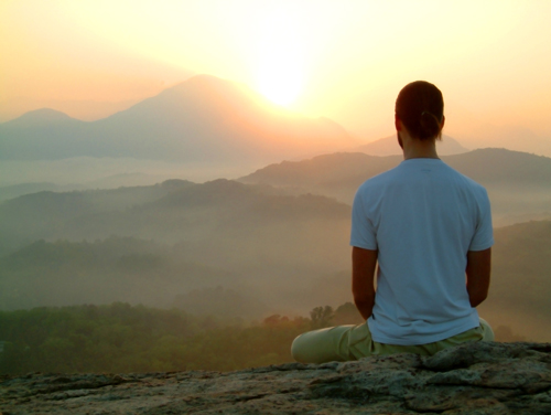 6 Tips to Make the Most of Your Recovery - man meditating at sunset