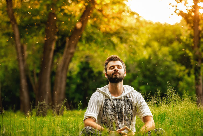 Man meditating outdoors - Ways to Prevent Relapse
