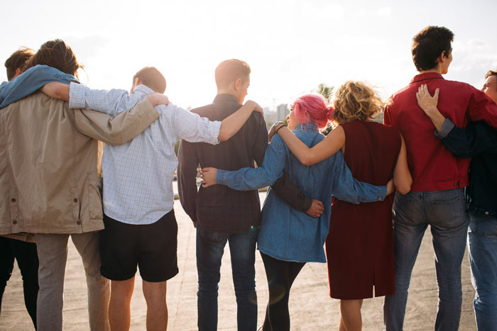 How Does a 12-Step Program Help You? - group of young people with arms around each other