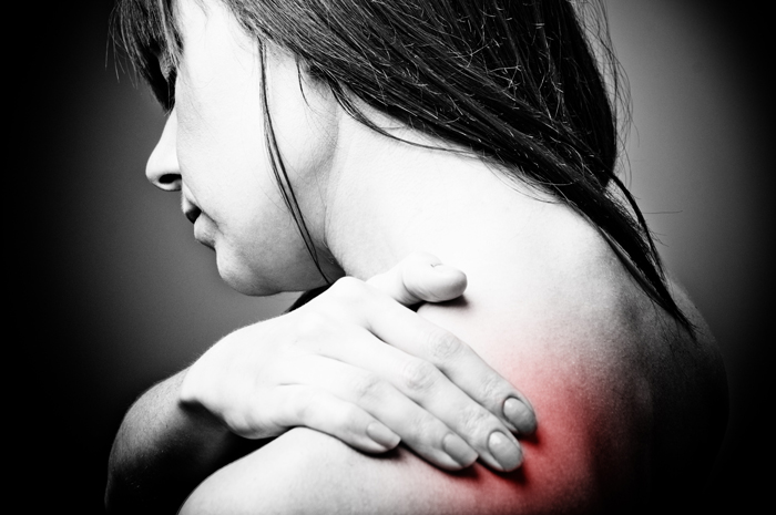 Treating Chronic Pain: When Opiates Aren't the Answer - grayscale woman hurt shoulder red added