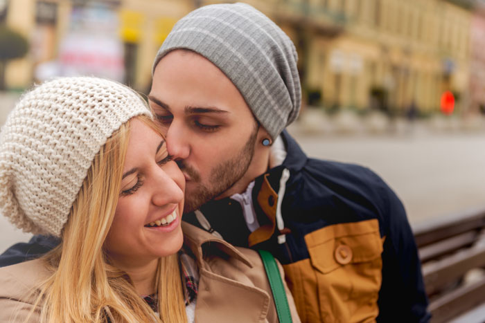 Dating-an-Addict-in-Recovery-How-to-Make-Your-Relationship-Stronger - young couple with stocking caps