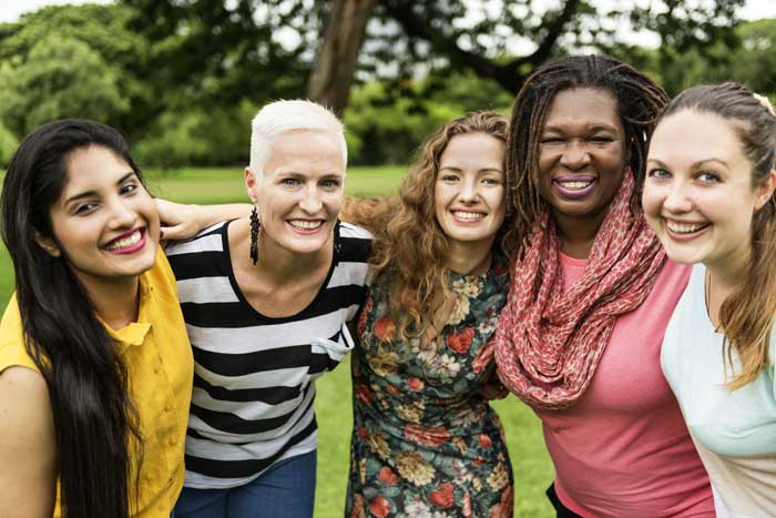 Understanding-the-Benefits-of-Transitional-Living-After-Treatment - diverse group of women outdoors hugging