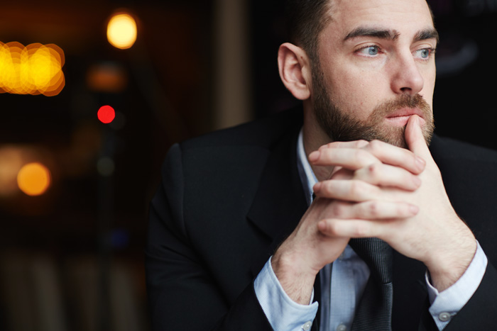 young business man pensive