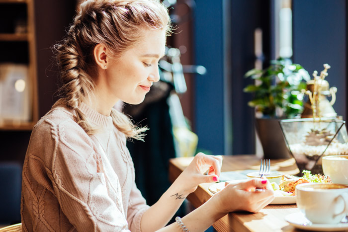 happy woman eating alone - lonely