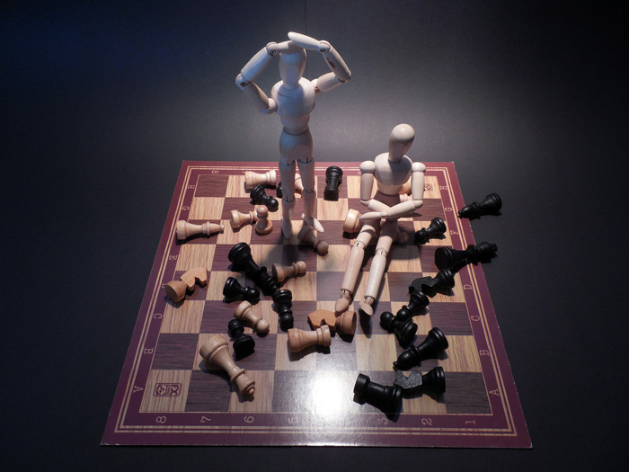 wooden figurines on chess board - rehab