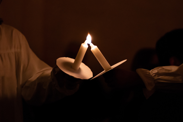 lighting handheld candles at vigil - your faith