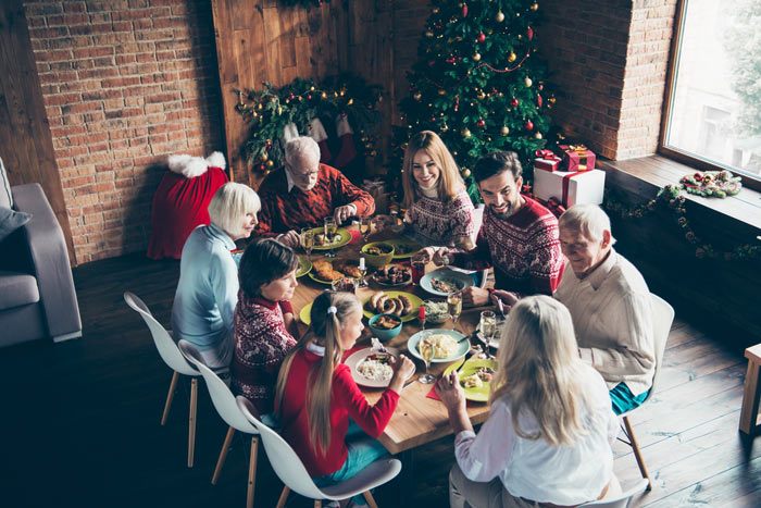 large family gathered around holiday meal - relatives